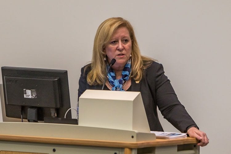 Linda Figg, CEO and president of Figg Bridge Group, presented the audience gathered at Saturday's Transportation Solutions Legislative Town Hall meeting a proposal for a New East County Bridge that she said her company could build for about $800 million. Photo by Mike Schultz