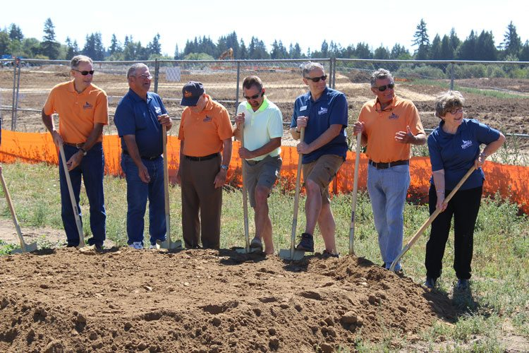 Members of the Ridgefield City Council prepare Thursday to lift the first shovels of dirt to commemorate the beginning of construction on the Ridgefield Outdoor Recreation Complex. Photo by Alex Peru