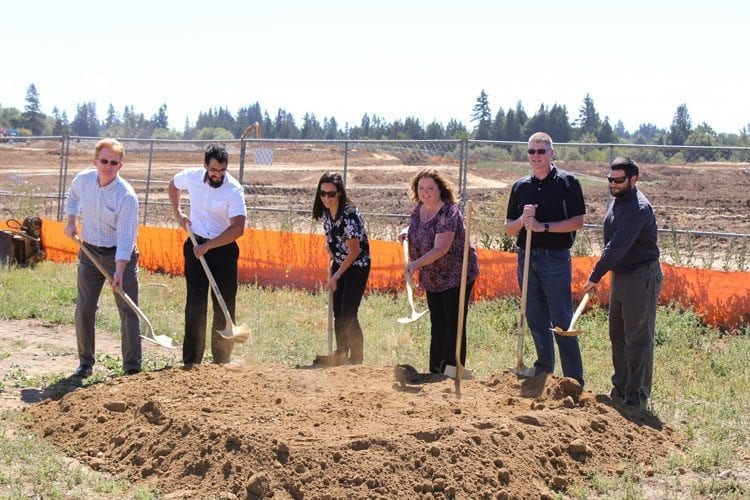 Dirt flew to cheers as the ceremonial first shovels of dirt were moved at the construction site for the outdoor and recreation complex Thursday. Photo by Alex Peru