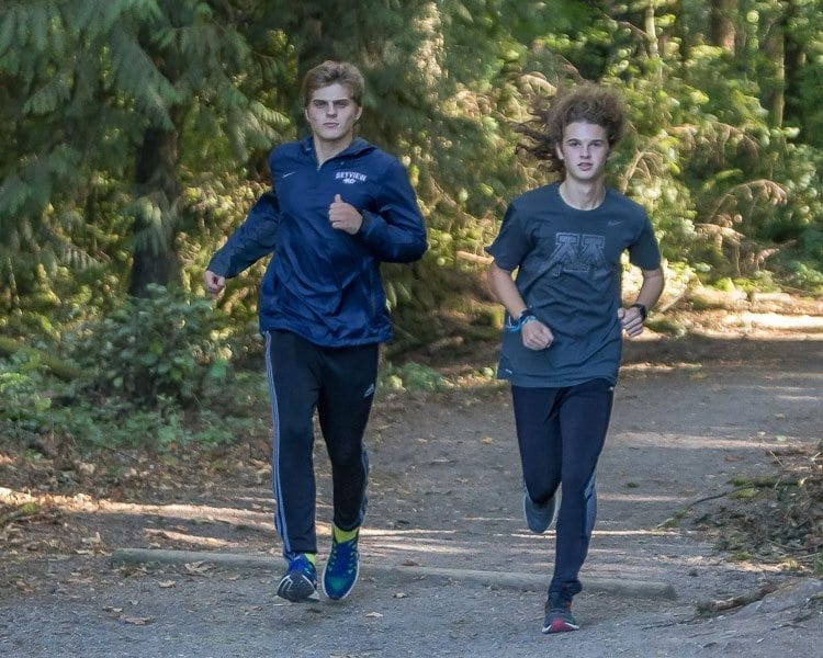 Joshua Verrinder (left) and Spencer Pugh, both juniors, are not household names in cross country but are a big part of Skyview's success as a team. Cross country is not all about the fastest runners. It's about running as a team. Photo by Mike Schultz