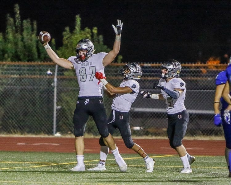 Union tight end Aiden Nellor (87) celebrates after scoring a touchdown in the Titans' last week win over Mountain View. Photo by Mike Schultz