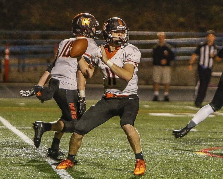 Washougal quarterback Ryan Stevens (11) attempts a pass during the Panthers' 34-14 victory over Ridgefield Friday. Stevens passed for 218 yards in Washougal's victory. Photo by Mike Schultz