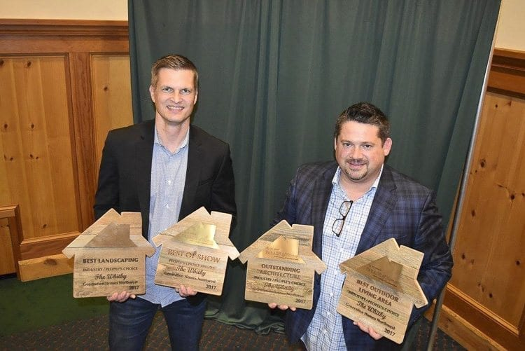 Aaron Helmes (left) and John Colgate, co-owners of Generation Homes Northwest, show off the four awards they were presented from their entry into the 40th annual NW Natural Parade of Homes. Photo courtesy of Building Industry Association of Clark County