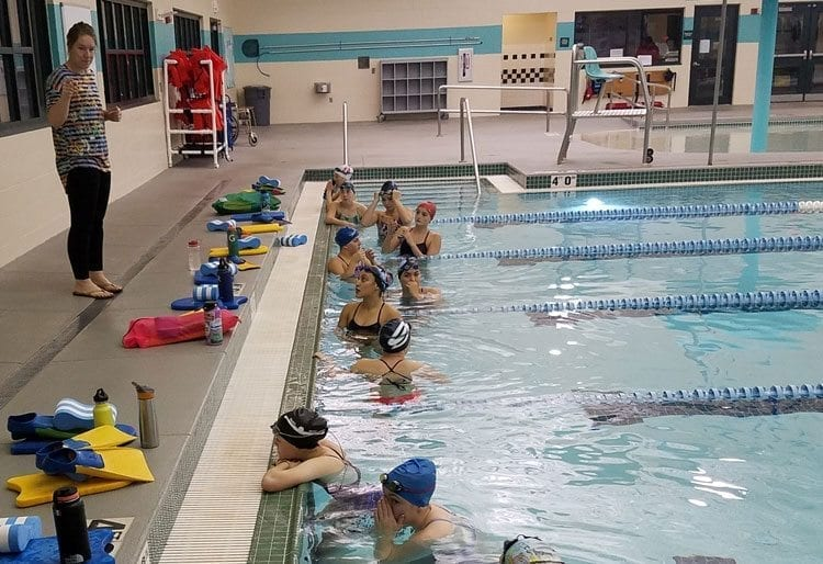 Columbia River coach Alyssa Manlow gives instructions to her swimmers at a recent practice. The Chieftains train at 5:15 a.m. every day before school. Photo by Paul Valencia