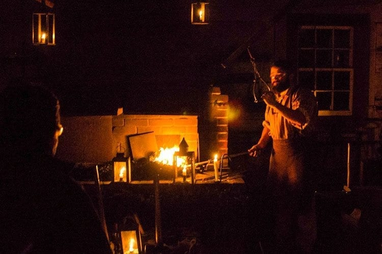 Lantern tours at Fort Vancouver allow visitors to see the fort at night, with all buildings and activities, such as the blacksmith workshop, lit by candles. Photo courtesy of the National Park Service