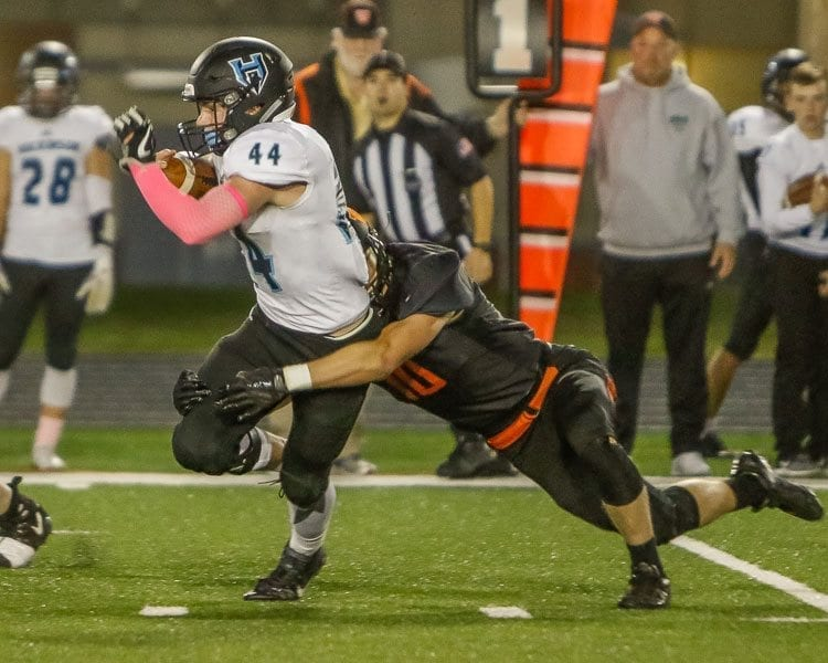 It hasn't been easy for opposing teams to slow down Hockinson this season. Here, running back Colton Wheeler (44) attempts to elude the grasp of a Washougal's Nathan Tofell (10) in a game earlier this season. Photo by Mike Schultz