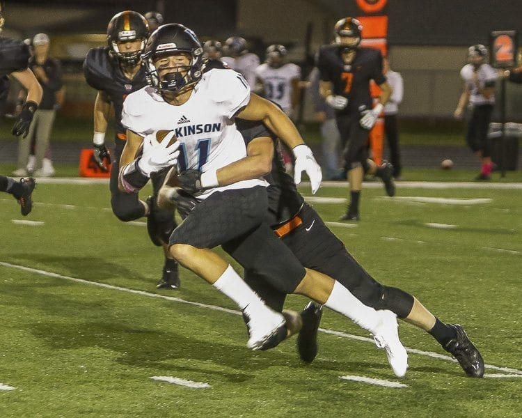 Hockinson receiver Sawyer Racanelli (11) advances the football after one of his six receptions Friday. Racanelli had two touchdowns to help the Hawks cruise to a 41-7 victory over Washougal. Photo by Mike Schultz