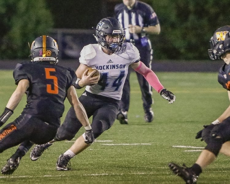Hockinson running back Colton Wheeler (44) looks for room to run against Washougal's defense Friday. Wheeler scored a touchdown and had 42 yards rushing in the Hawks' win at Washougal. Photo by Mike Schultz
