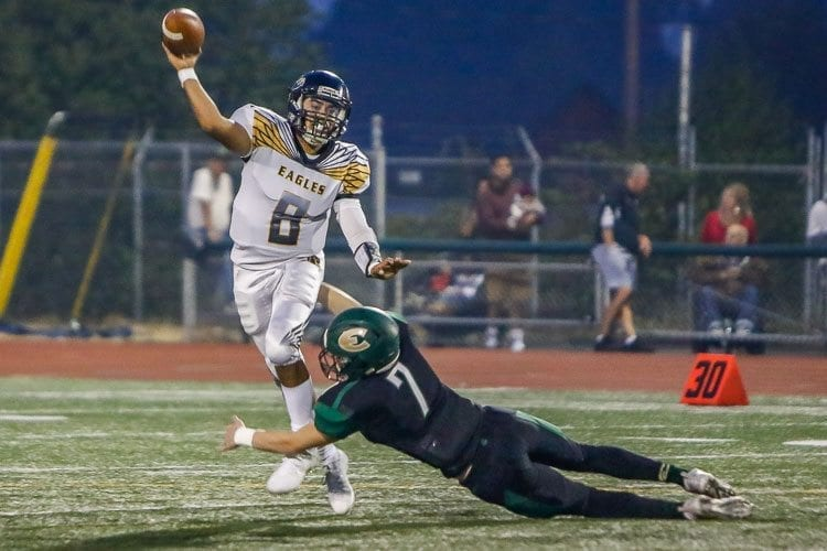Hudson's Bay coach Ray Lions named quarterback Brian Perez (8), shown here in a game against Evergreen earlier this season, as his team's Most Valuable Player in last week's win over Mark Morris. Photo by Mike Schultz