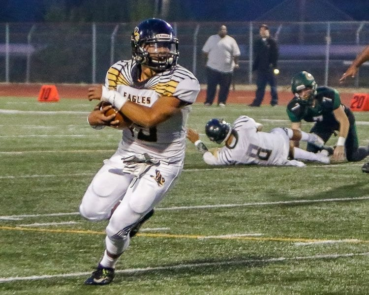 Hudson's Bay running back Akilotoa Kaumatule (15), shown here in a game against Evergreen earlier this season, is the thunder in the Eagles' thunder and lightning offensive attack. Photo by Mike Schultz