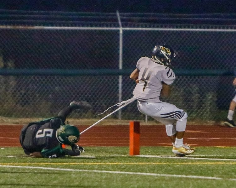 Quadrese Teague (4), shown here scoring a touchdown in a game earlier this season with Evergreen, scored two touchdowns on kickoff returns in last week's game with Mountain View. Photo by Mike Schultz