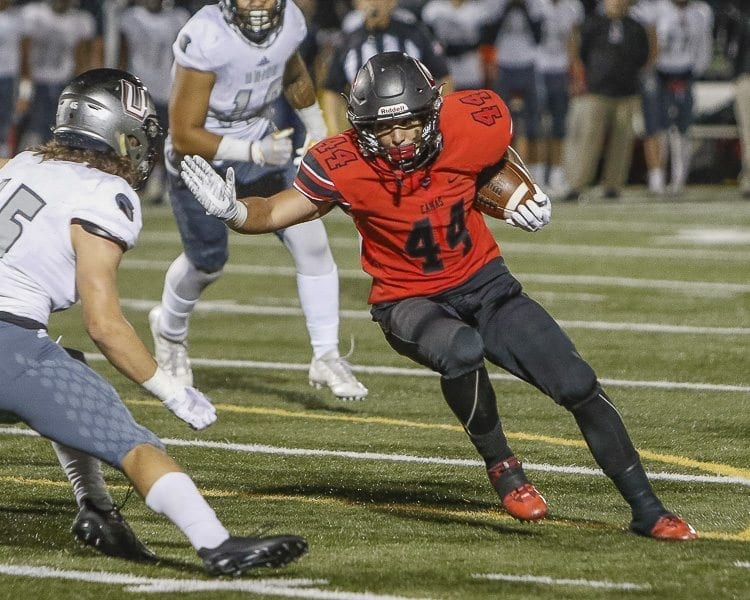 Camas running back Semisi Schultz (44) scored both of his team's touchdowns in Friday's 14-13 loss to Union at Doc Harris Stadium in Camas. Photo by Mike Schultz