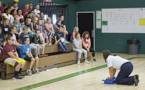 Kanessa Thompson, a paramedic and Communications Coordinator for Clark County EMS, teaches students at Woodland Middle School how to perform CPR. Photo courtesy of Woodland Public Schools