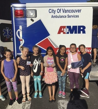 Students enjoyed going on a tour of an ambulance brought by Kanessa Thompson, of Clark County EMS, and Ben Huebschman, Multnomah County EMS. Photo courtesy of Woodland Public Schools