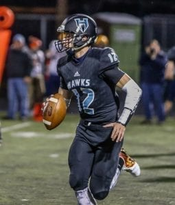 Hockinson quarterback Canon Racanelli (12) threw six touchdown passes in the Hawks' win over Aberdeen last week. The senior signal caller will lead his team into the first round of the state playoffs this week against Pullman. Photo by Mike Schultz