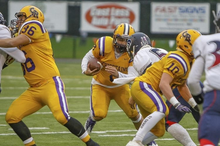 Columbia River quarterback Julian Garcia (8) looks for some running room Saturday against Black Hills. Garcia scored the Chieftains' only touchdown and finished with a team-high 75 yards rushing. Photo by Mike Schultz