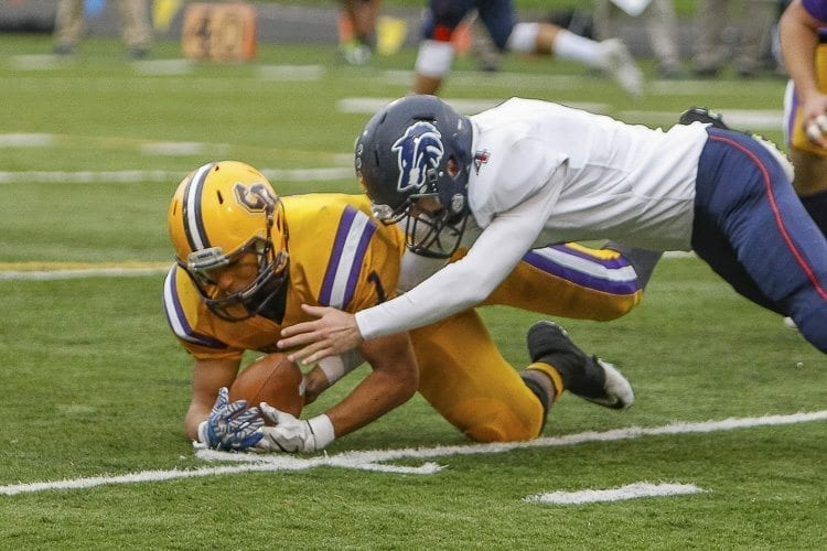Columbia River's Logan Wilson (1) recovers a fumble that led to the Chieftains' only touchdown of the game Saturday. Photo by Mike Schultz