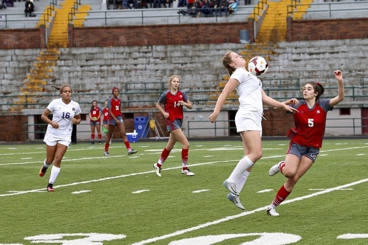 Columbia River forward Sophia Skimas controls a ball against Bellingham in Saturday's quarterfinal matchup. She would later net a goal in penalty kicks, helping the defending state champions return to the final four. Photo by Dawn Anthony