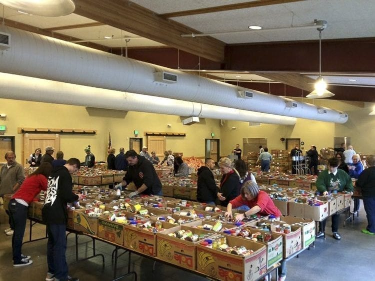 Volunteers will gather in the Battle Ground Community Center on Dec. 12 and 13 to pack food boxes for distribution in the annual Christmas Food Box Program. Photo courtesy of North County Community Food Bank