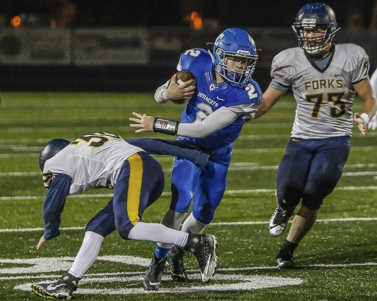 La Center running back Hayden Williamson (2) rushed for some of his 71 yards in Friday's playoff game with Forks. Williamson had a 33-yard touchdown run in the Wildcats' 49-12 victory. Photo by Mike Schultz