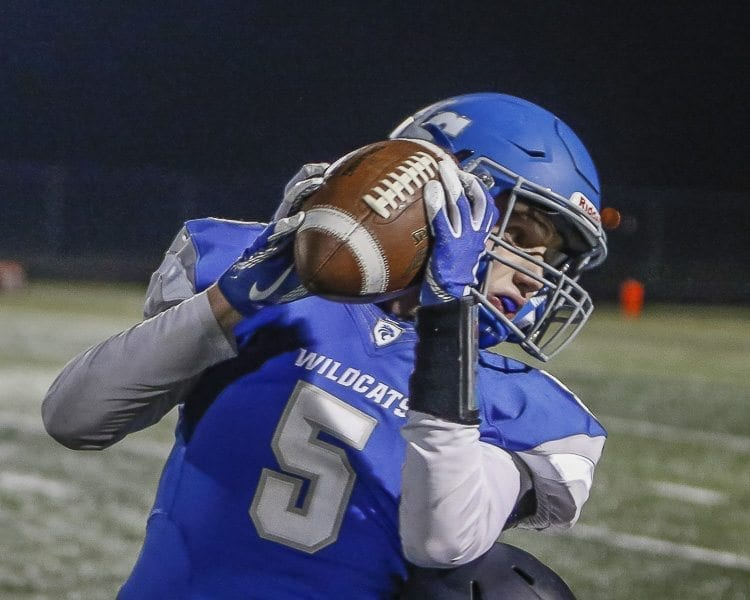 La Center tight end Jackson Leslie (5) hauls in a pass during the Wildcats' 49-12 victory over Forks Friday at Woodland High School. Photo by Mike Schultz