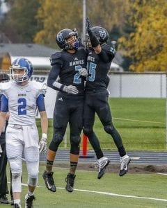 Hockinson's Matt Henry (25) celebrates one of his three touchdowns with teammate Jake Beslanowitch (2) during Friday's state playoff game at District Stadium in Battle Ground. Photo by Mike Schultz