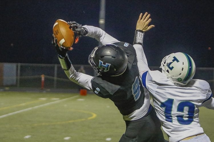 Hockinson receiver Peyton Brammer (9) makes a eye-opening catch during the Hawks' victory over Liberty Saturday at District Stadium in Battle Ground. Photo by Mike Schultz