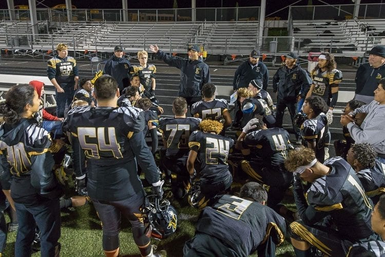 The Hudson's Bay Eagles, shown here gathering after their victory in a tiebreaker against Evergreen and Prairie, earned a trip to the postseason and the reward was a road game against perennial state power Bellevue Saturday. Photo by Mike Schultz