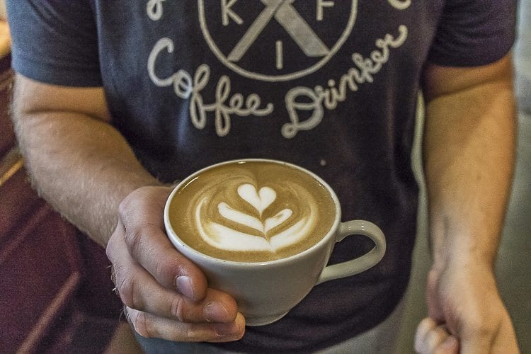 Matthew Selivanow demonstrated the presentation of his coffee with an example of latte art. Photos by Mike Schultz