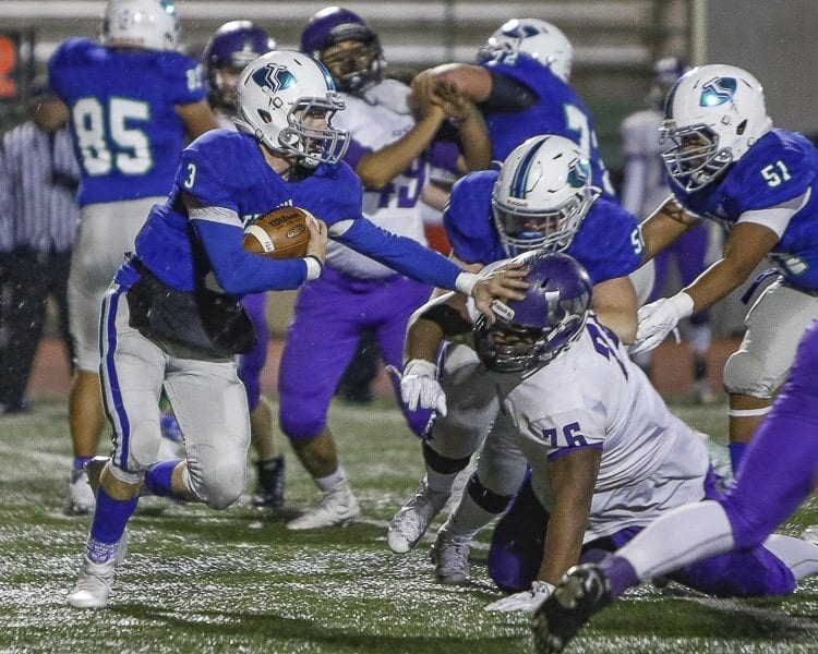 Glen Perry Jr. rushed for 243 yards and three touchdowns, helping Mountain View beat Lake Washington 27-10 Saturday night. Photo by Mike Schultz
