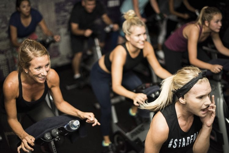 Each StarCycle class is led by an instructor and lasts 45 minutes, giving participants a full-body workout on stationary bicycles. Photo courtesy of StarCycle