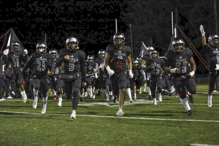 The Union Titans take to the field in preparation of their game against Tahoma on Friday night. Union went on to win 41-14. Photo by Heather Tianen