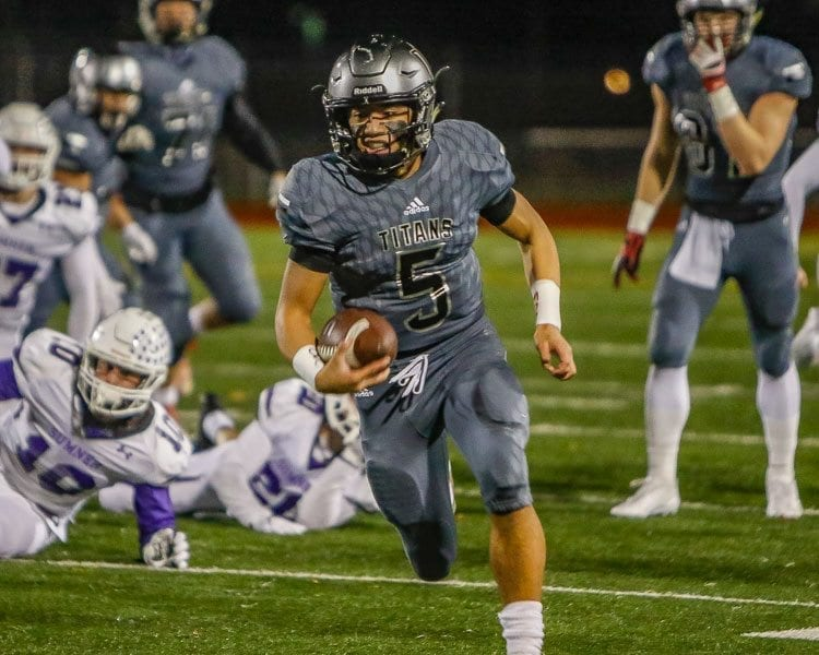 Union quarterback Lincoln Victor (5) runs for yardage in the Titans' playoff game Friday at McKenzie Stadium. Victor suffered an injury and had to leave the game in the second quarter. Photo by Mike Schultz