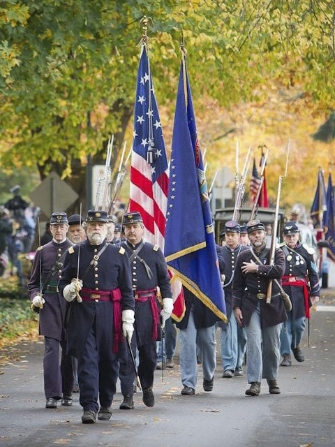 The annual Veterans Day Parade aims to honor both past and present veterans with historic reenactors also playing a role in the celebration. Photo by Mike Schultz