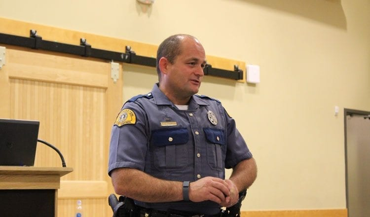 Trooper Richard Thompson of Washington State Patrol's License Investigation Unit gave a presentation to an assembly of local city councilors and mayors in Battle Ground outlining the State Patrol's efforts to enforce state licensing and vehicle registration laws. Photo by Alex Peru