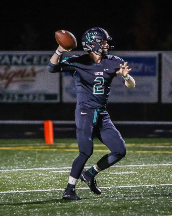 Woodland quarterback Wyatt Harsh (2), shown here in a game earlier this season, threw for 312 yards in the Beavers' heart-breaking 38-35 loss to W.F. West Friday. Photo by Mike Schultz