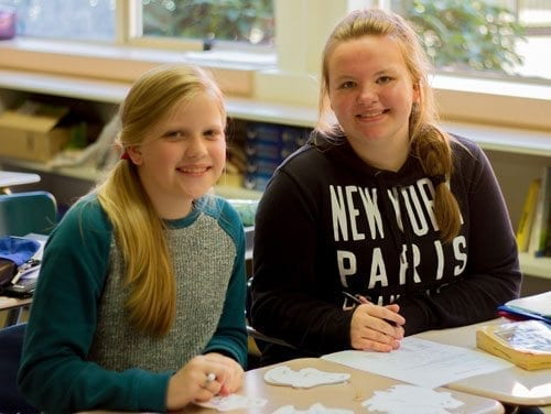 Eighth graders Casey Logan and Maci Stapleton work on planning the next big school activity to motivate their classmates to get involved and support their school. Photo courtesy of Woodland Public Schools