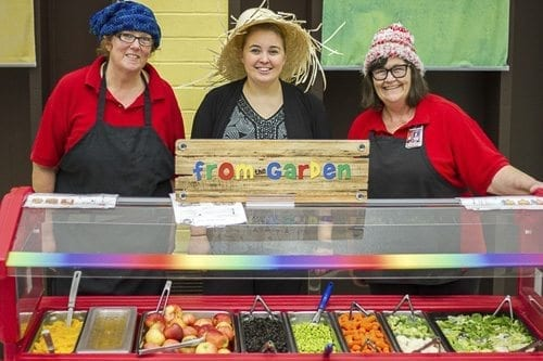 Laura Perry (center) works with Woodland Primary School's chefs Cris Forgey (left) and Judi Lute (right) to introduce a new fruit and vegetable each week using the letters of the alphabet. Photo courtesy of Woodland School District