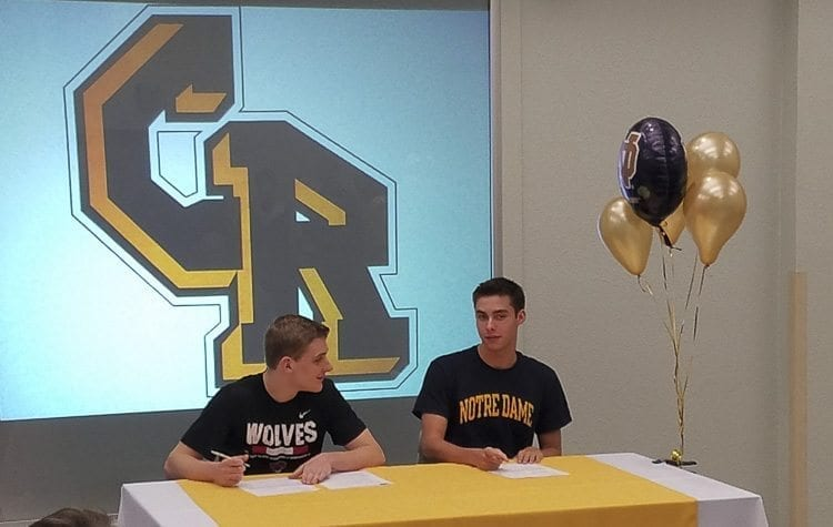 Jacob Hjort, left, and Josh Bottelberghe were honored at a signing ceremony at Columbia River High School. Bottelberghe, one of the top swimmers in the country, signed with Notre Dame. Hjort will play basketball at Western Oregon. Photo by Paul Valencia