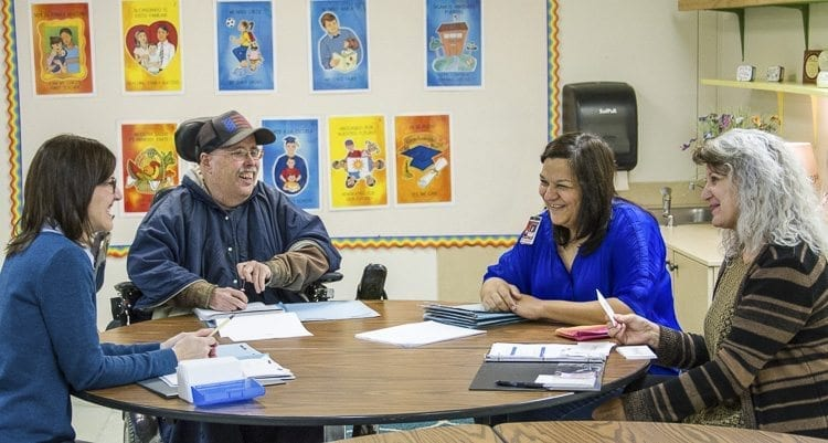 Woodland Public Schools' staff members in Milagros Wells' classes work together to help one another become more comfortable using their new skills. Photo courtesy of Woodland Public Schools