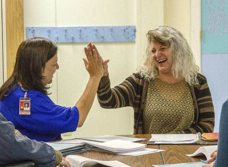 Woodland English Language Learner Outreach Coordinator Milagros Wells (left) works with each staff member one-on-one to ensure they understand proper pronunciation and sentence structure. Photo courtesy of Woodland Public Schools