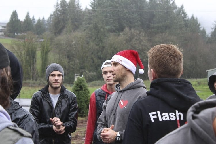 After the Christmas trees for distribution had been loaded, Andrey Ivanov rallied the members of Flash Love and reminded them of the significance of helping others selflessly even in small ways. Photo by Alex Peru
