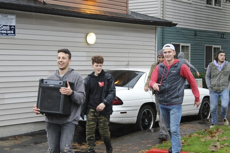 The Flash Love crew stormed local neighborhoods and apartment complexes eager to deliver Christmas trees and holiday cheer to families in need, all while blasting Christmas music wherever they went. Photo by Alex Peru