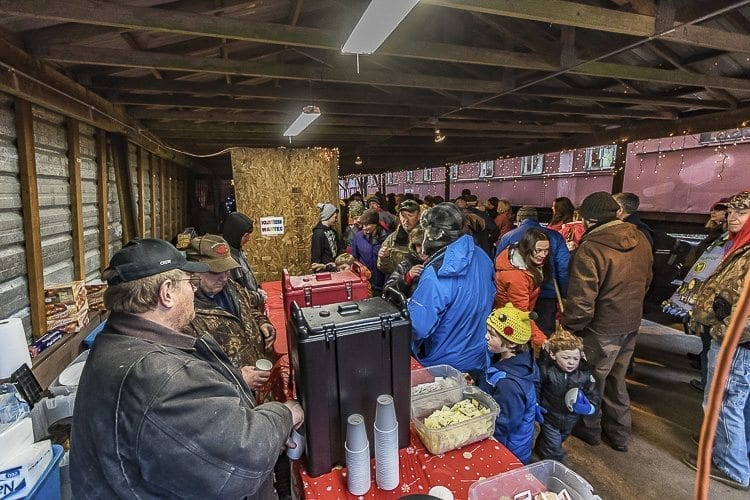 Passengers on the Chelatchie Prairie Railroad's steam train disembarked at a station near Moulton Falls to get hot beverages and give children a chance to meet with Santa Claus. Photo by Mike Schultz