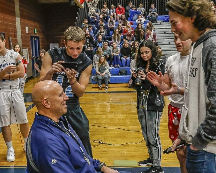 Hockinson football coach Rick Steele (seated) got his mustache shaved by Hawks player Blake Sparks (right). Sparks made a deal with his coach that if the team won the Class 2A state championship, he would get to shave his coach's signature mustache. Photo by Mike Schultz