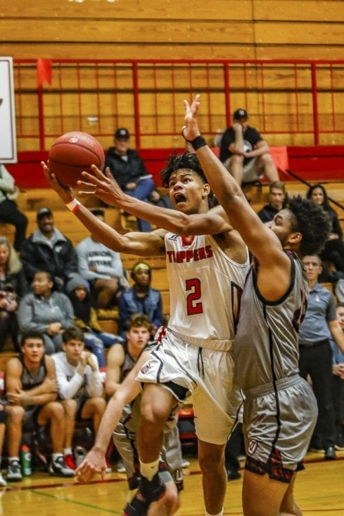 Fort Vancouver guard Johnny Green (2) drives past a Union defender for a shot attempt during Tuesday's game at Fort Vancouver High School. Photo by Mike Schultz