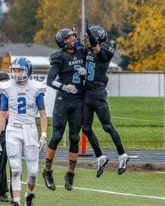 Hockinson receivers Jake Beslanowitch (2) and Matt Henry (25) celebrate after a touchdown in a playoff game with Pullman. The Hawks hope to have the opportunity to celebrate a number of touchdowns during Saturday's Class 2A state championship game against Tumwater at the Tacoma Dome. Photo by Mike Schultz