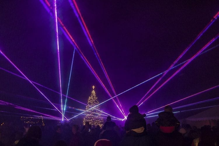 After the Christmas tree was lit in La Center, crowds were awed by a laser show presented by La Center company Laseronics. The laser show was a first for the annual Christmas Festival, replacing a fireworks display held in past years. Photo by Mike Schultz
