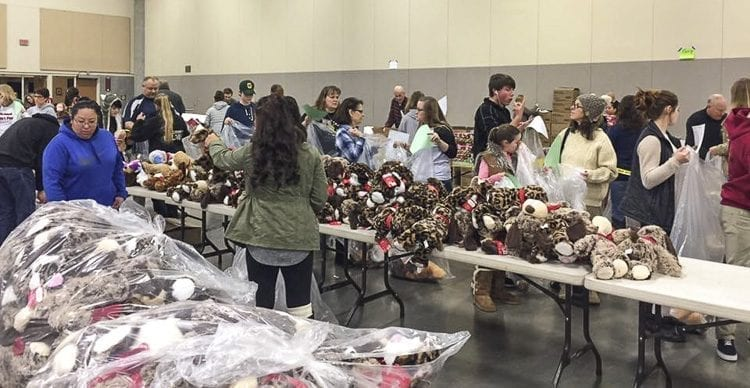 Santa's Posse is a partnership between the Clark County Sheriff's Office and local sponsors that seeks to provide food and gifts for Clark County families in need. It relies completely on volunteers, and every year holds a wrapping party at the Clark County Events Center to prepare gifts for distribution. Photo courtesy of Santa's Posse