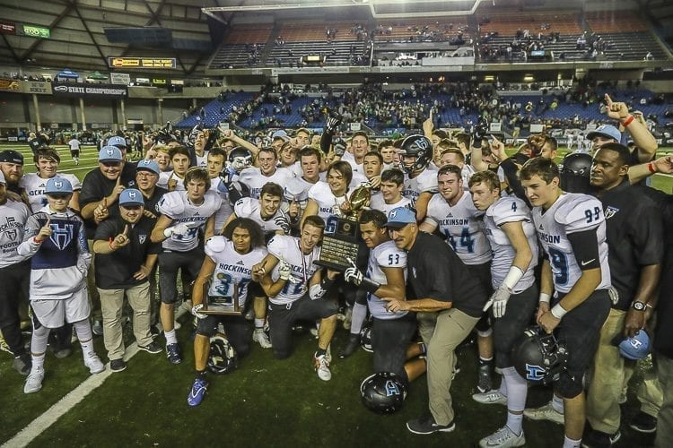 The 2017 Hockinson High School football team poses with the Class 2A state championship trophy Saturday after defeating Tumwater 35-22 in the championship game at the Tacoma Dome. Photo by Mike Schultz
